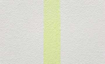 An image of a textured white wall with a pale yellow stripe running down the centre.