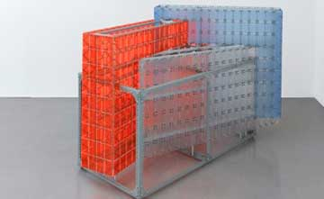 An art installation featuring a metal rectangular structure holding sheets of thick plastic.