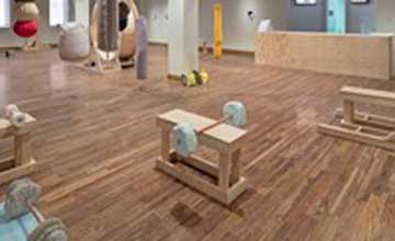 An art installation in which simple gym equipment is recreated in wood and textile.